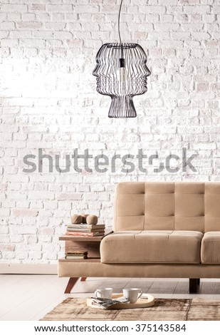 modern sofa living room with stone wall and modern lamp