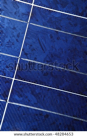 Modern solar photo voltaic panel close up with great blue cells details in a perspective view. Great for energy and environment themes.