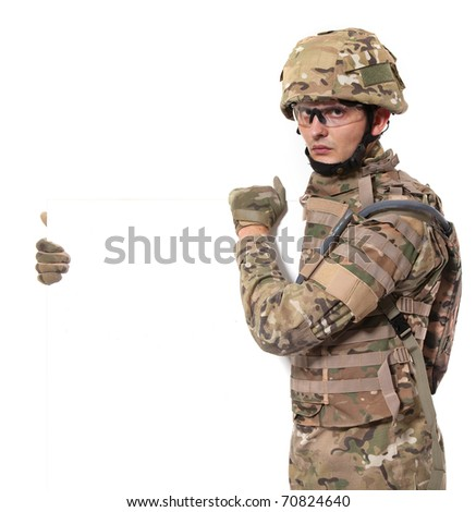 Modern soldier holding a poster isolated on white