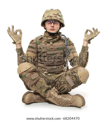 Modern soldier meditating. Isolated on a white background - stock photo
