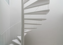 Modern space with white spiral stair