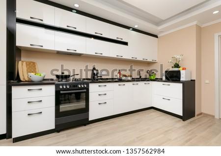 Modern spacioius black and white kitchen, clean design
