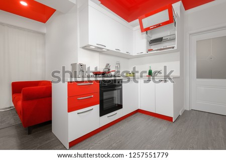 Modern spacioius red and white kitchen in apartment, premium clean design
