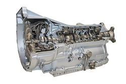 Modern 8-speed automatic transmission for cars isolated over white.