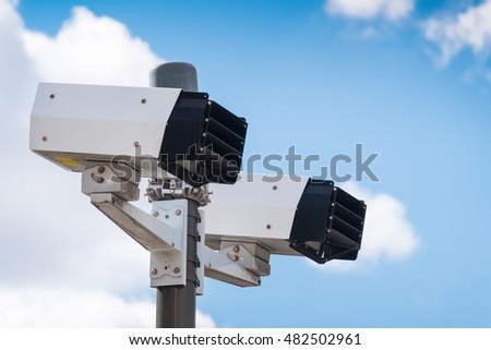 Modern speed camera with sky on the background #482502961