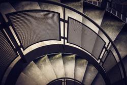 Modern spiral staircase with metallic hand-rails. LOMO effect