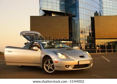 Modern sport car near the office building