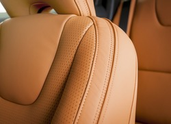 Modern sport car  red sand perforated leather interior. Part of  leather car headrest seat details.