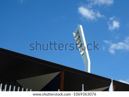 Modern sports arena illumination tower #1069363076