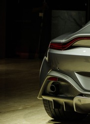 Modern sports car tail light and exhaust pipe rear view