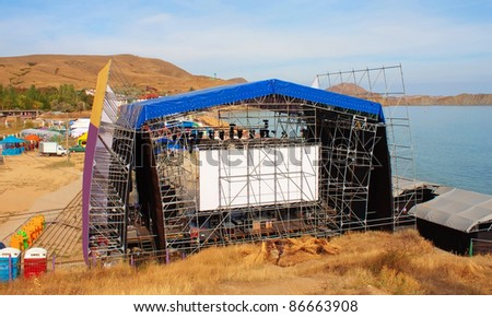 Modern stage on the beach, openair festival