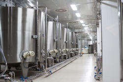 modern Stainless shine wine reservoirs  in a row inside winery