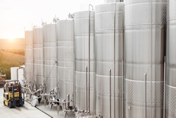 Modern stainless steel barrels for wine fermentation at a winery. Wine industry.