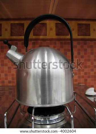 Modern stainless steel kettle on cooker
