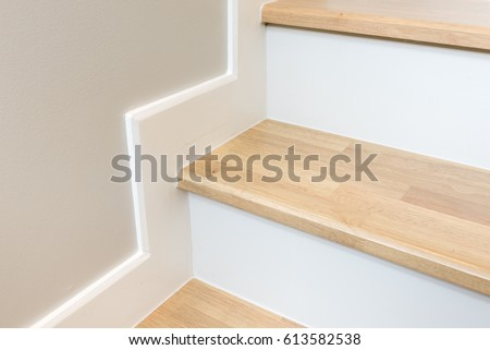 modern stair design with wooden tread and white riser, white skirting on wall, interior concept stock photo