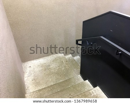 Modern staircase, Staircases in reinforced concrete building, Stainless steel railings inside building, New concrete stairs in office building. Close up and details of railing and stairs #1367989658