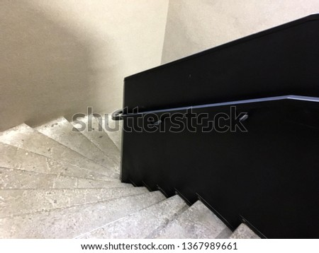 Modern staircase, Staircases in reinforced concrete building, Stainless steel railings inside building, New concrete stairs in office building. Close up and details of railing and stairs #1367989661