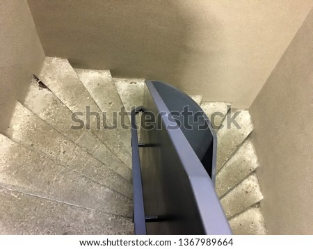 Modern staircase, Staircases in reinforced concrete building, Stainless steel railings inside building, New concrete stairs in office building. Close up and details of railing and stairs #1367989664