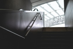 modern stairs dark background staircase in gray with bright light and no people .