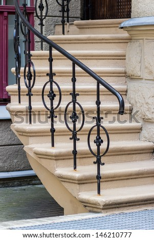 Modern stairs with metalic handrail - stock photo