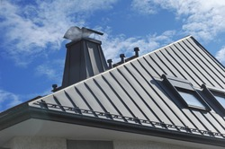 Modern Standig Seam Metal Roof with Roof Window, Fume Hoods, Snow Guard, rain Gutter and Metal plastered Chimney