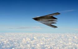 Modern stealth bomber flying at high altitude
