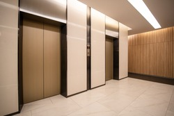Modern steel elevator cabins in a business lobby or Hotel, Store, interior, office,perspective wide angle. Three elevators in hotel lobby