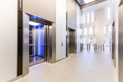 Modern steel elevator doors opened cabins in a business lobby or Hotel, Store, interior, office,perspective wide angle. elevators in hotel lobby.