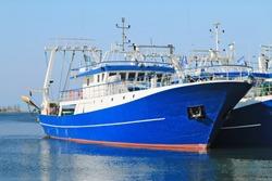 Modern steel fishing ships docked in port