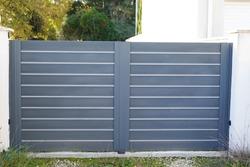 modern steel grey gate aluminum portal with blades suburbs house street