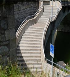 Modern steep cement /concrete stairs steps beside the bridge in Eglisau, Switzerland. The way to success concept idea.