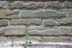 Modern stone brick wall tile texture. Rough outdoor decorative slate. Masonry mixed block facing background, real rock tile surface with cement. Cladding of buildings with natural materials.
