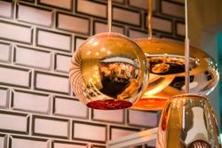 Modern streamlined mirror oval copper chandelier. Bubble metal copper shade pendant.