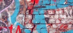 Modern Street Art Background Or Texture. Grunge Brick Wall With Graffiti Art. Urban Surface With Grafiti. Old Building Brickwall With Modern Street Grafitti Art Fragment. Abstract Web Banner