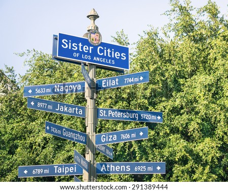 Modern street sign of Sister Cities of Los Angeles - Urban concept and road traffic directions in California - Twinning concept with world famous capital destinations - Soft vintage filtered look