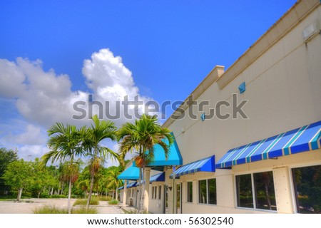 Modern Strip Shopping Mall with colorful awnings