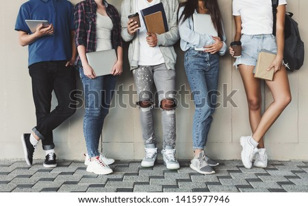 Modern students. Group of Diverse Teenagers Posing with Gadgets and Books, panorama with empty space