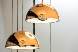 Modern style bronze decoration lamps and lampshades against white wall.