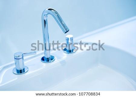 Modern style chrome bathroom tap in modern bathroom.
