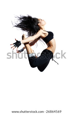 modern style dancer jumping behind studio background