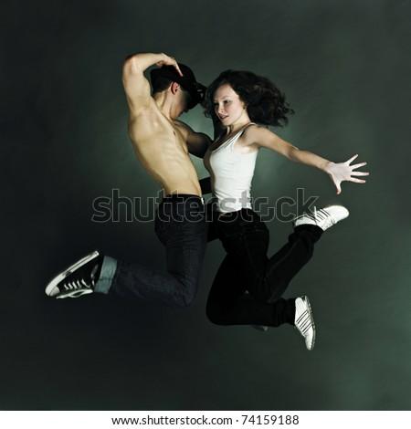 modern style dancer posing on grunge grey background