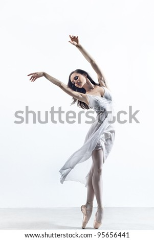 modern style dancer posing on studio background