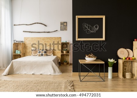 Modern style home interior with wooden furniture and blackboard wall