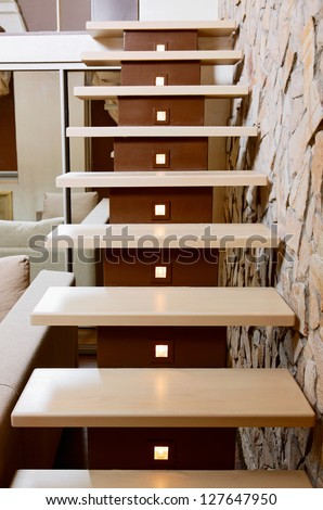 Modern style staircase and ashlar wall, interior detail