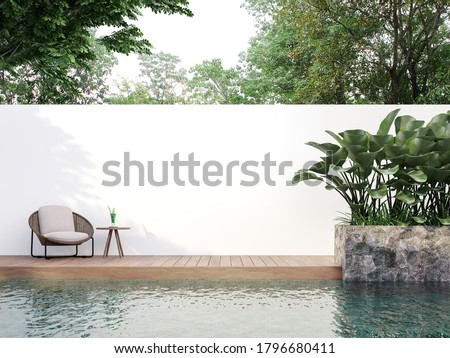 Modern style swimmimg pool terrace with blank wall for copy space 3d render, There are wooden floor,green tile in the swimming pool and ,empty white wall,Surrounded by nature.