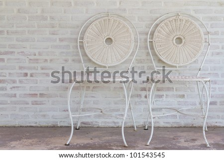 Modern stylish chair against a brick wall