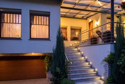 Modern stylish house with lighted outside stairs
