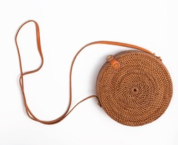 Modern stylish round straw bag isolated on the white background, top view