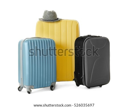 Modern suitcases and hat isolated on white #526035697