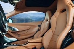 Modern supercar interior with leather panel, sport seats, multimedia and digital dashboard